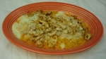 Chicken & Rice - Grilled chicken with rice, topped with cheese sauce.